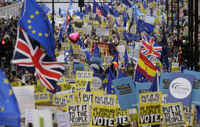Demonstrators carry posters and flags during peoples anti-brexit march in London